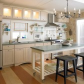 Bright and coastal KraftMaid kitchen with cabinetry in Biscotti with Coconut Glaze