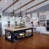 Vintage Onyx island offers a stylish counterpoint to the Canvas on Maple cabinetry