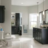 KraftMaid dark cabinetry in this minimalist bath